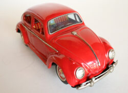 Yoshiya KO Japan 60's battery operated tin Volkswagen Beetle with blue visible engine with light, original tin toy car