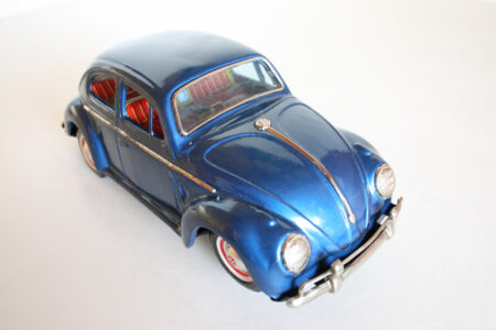 Yoshiya KO Japan 60's battery operated tin Volkswagen Beetle with red visible engine with light, original tin toy car